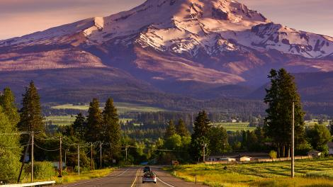 Scenic drive in front of a snow-covered mountain
