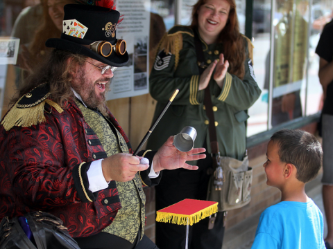 A steampunk magician delights his audience