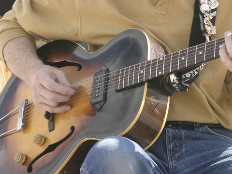 Strumming the guitar at the Cheyenne Arts Festival