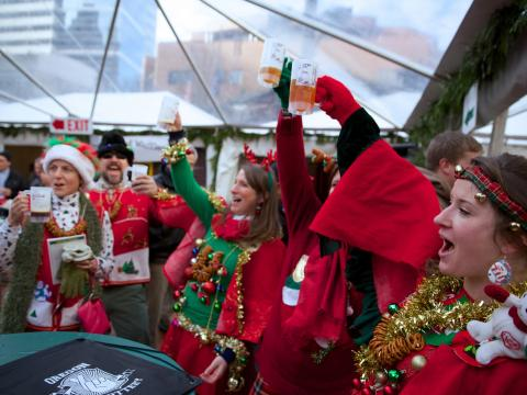 Toasting in holiday-themed attire at Portland's Holiday Ale Festival