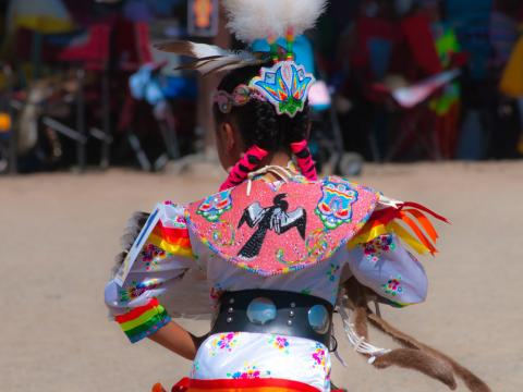 A dancer participates in the Ute Mountain Bear Dance ceremony