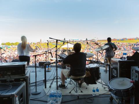 Live performance overlooking the lawn at KCQ Country Music Festival