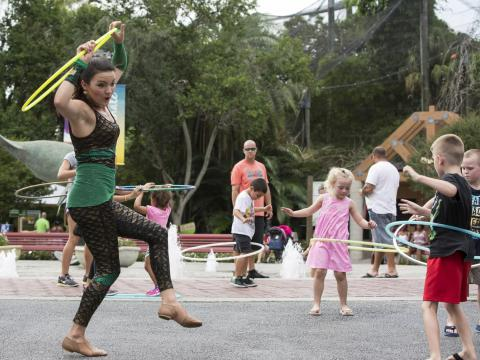 Hula hoop lessons during the Sunset Celebration at ZooTampa at Lowry Park